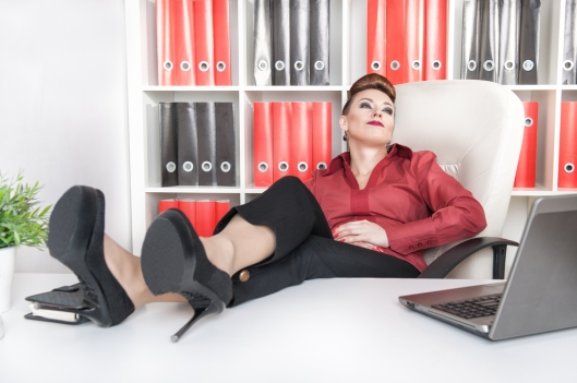 Business woman with feet on desk.jpg